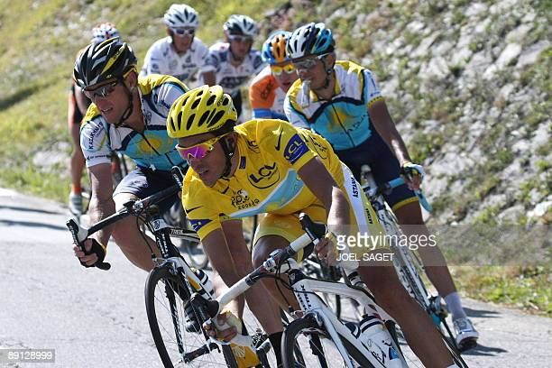 Yellow jersey of overall leader 2007 Tour de France winner Alberto Contador of Spain rides with seventime Tour de France winner and Kazakh cycling...