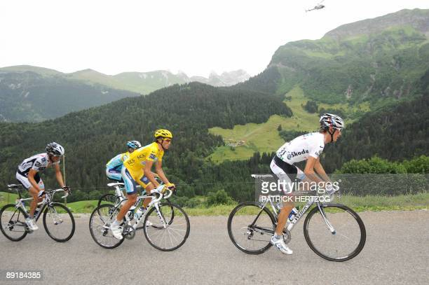 Yellow jersey of overall leader 2007 Tour de France winner and Kazakh cycling team Astana 's leader Alberto Contador of Spain rides with Danish...