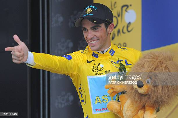 Yellow jersey of overall leader, 2007 Tour de France winner and Kazakh cycling team Astana 's leader Alberto Contador of Spain, gestures on the...