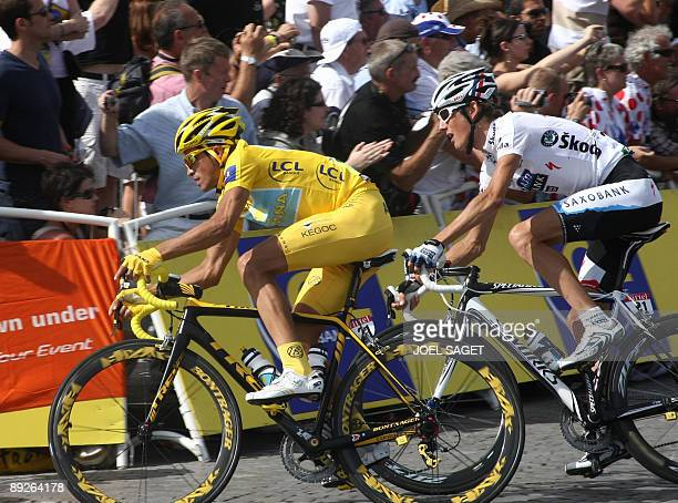 Yellow jersey of overall leader, 2007 Tour de France winner and Kazakh cycling team Astana 's leader Alberto Contador of Spain rides with second...