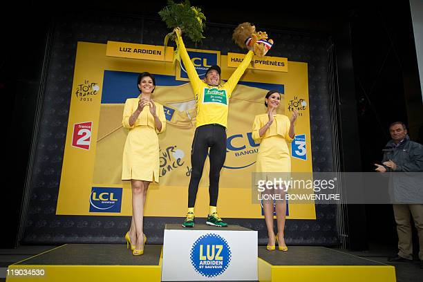 Yellow jersey of overall leader, France's Thomas Voeckler, celebrates on the podium at the end of the 211 km and twelfth stage of the 2011 Tour de...