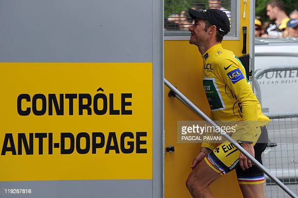 Yellow jersey of overall leader France's Thomas Voeckler enters the antidoping control bus at the end of the 1525 km and thirteenth stage Yf the 2011...