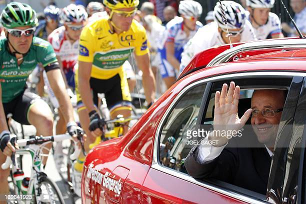 Yellow jersey of overall leader France's Thomas Voeckler rides behind the official Tour de France car where French Socialist Party MP and contender...