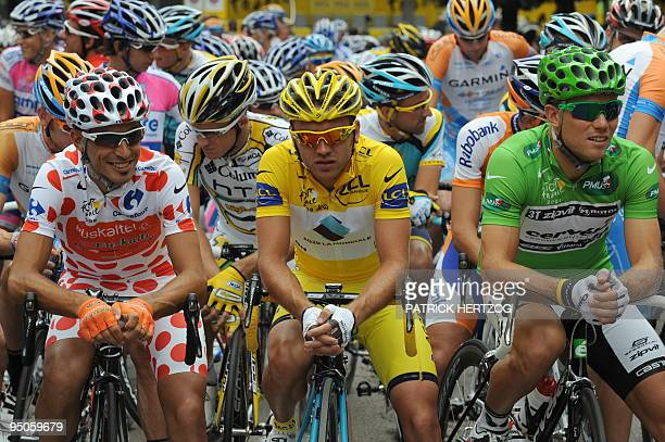 Yellow jersey of overall leader French cycling team AG2RLa Mondiale 's Rinaldo Nocentini concentrates with polka dot jersey of best climber Spanish...