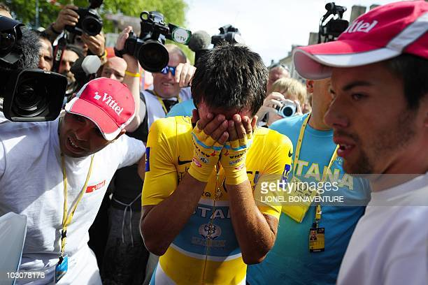 Yellow jersey of Overall leader, Spain's Alberto Contador, cries at the end of the 52 km individual time-trial and 19th stage of the 2010 Tour de...