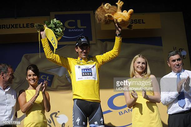 Yellow Jersey of Overall leader, Switzerland's Fabian Cancellara , flanked by French former Tour de France winner Bernard Hinault and Belgium's...