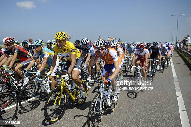 Yellow jersey of overall leader, Switzerland's Fabian Cancellara rides in the pack on July 4, 2010 at the start of the 223,5 km and first stage of...