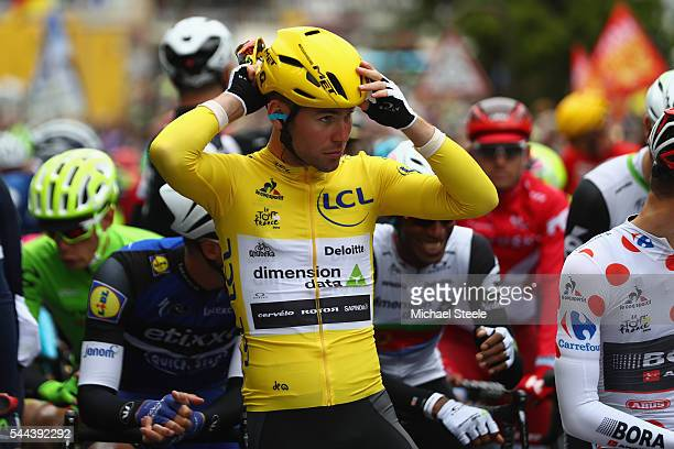 Yellow jersey race leader Mark Cavendish of Great Britain and Team Dimension Data prepares on the starting line ahead of stage two of Le Tour de...