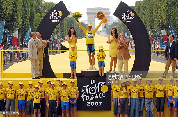 Yellow jersey Spain's Alberto Contador celebrates his victory on the winners' podium of the 94th Tour de France cycling race after the twentieth and...