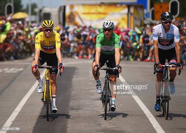 Yellow jersey wearer Rohan Dennis of Australia and BMC Racing Team green jersey wearer Tony Martin of Germany and EtixxQuick Step and white jersey...