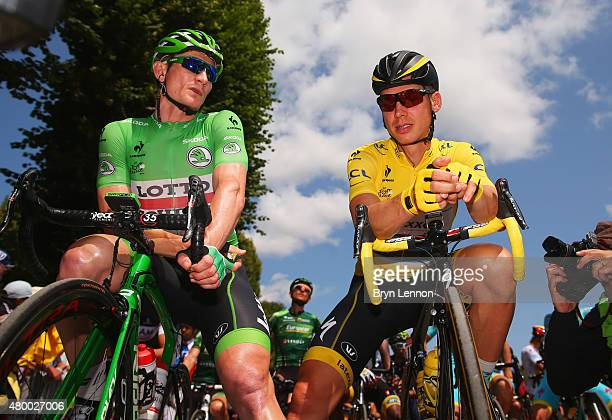 Yellow jersey wearer Tony Martin of Germany and EtixxQuick Step and green jersey wearer Andre Greipel of Germany and LottoSoudal in discussion prior...