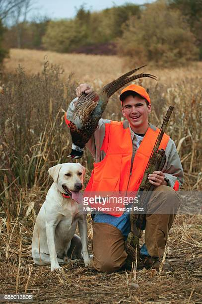 Yellow Lab And Young Male Upland Bird Hunter