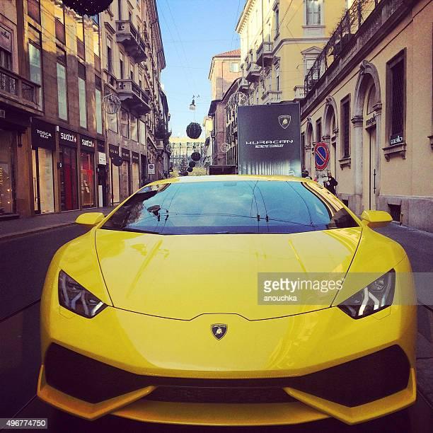 yellow lamborghini displayed on via monte napoleone, milan - lamborghini stock pictures, royalty-free photos & images