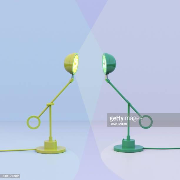 Yellow lamp facing a green lamp.