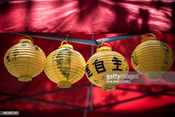 Yellow lanterns decorated with prodemocracy slogans are displayed outside the government headquarters building to mark one year since the start of...