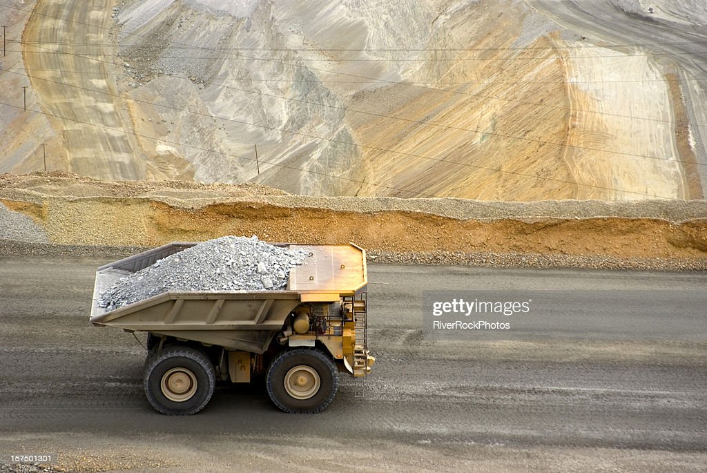 Yellow large dump truck in Utah copper mine seen from above : Stock Photo