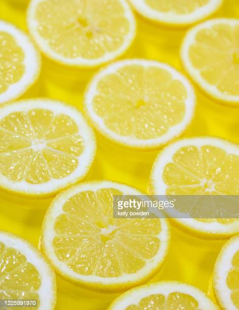 yellow lemon slices healthy diet detox background - kelly bowden stock pictures, royalty-free photos & images