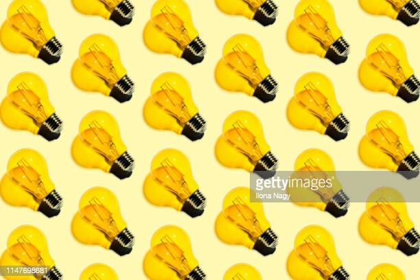 yellow light bulbs - idea fotografías e imágenes de stock