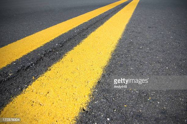 yellow lines - dividing line road marking stock pictures, royalty-free photos & images