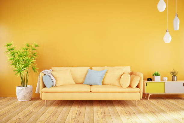 yellow living room with sofa - indoors stock pictures, royalty-free photos & images