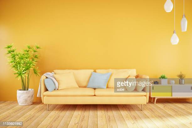 yellow living room with sofa - multi colored stock pictures, royalty-free photos & images