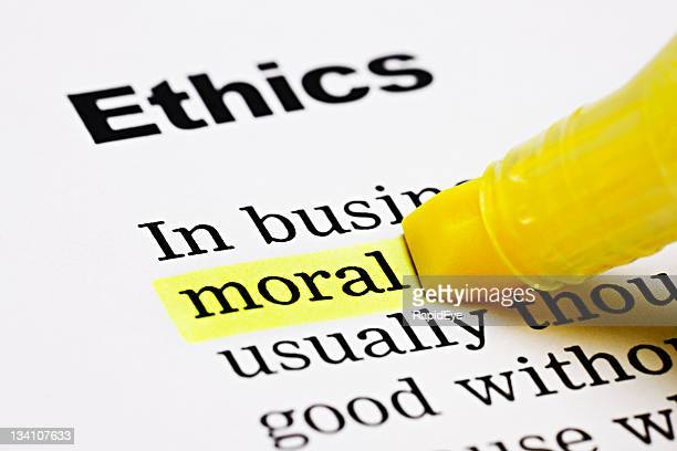 yellow marker highlights 'moral' in ethics document - morality stock pictures, royalty-free photos & images