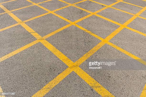 Yellow marking on tarmac