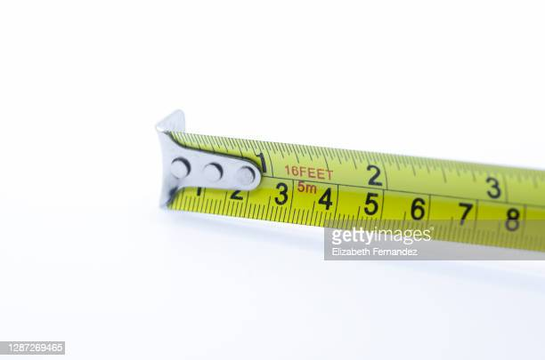 yellow measure tape on white background - inch stock pictures, royalty-free photos & images