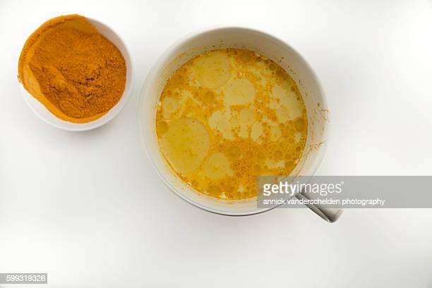 Yellow milk and turmeric powder.