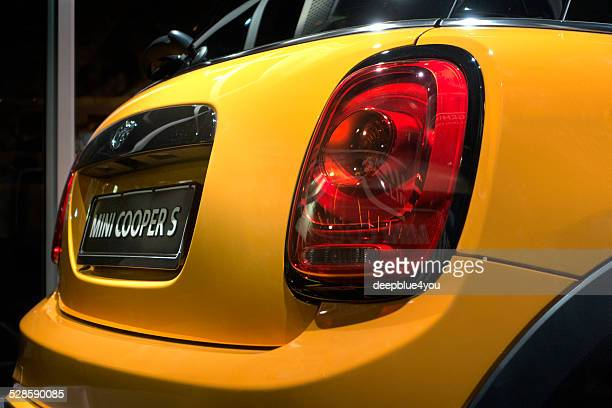 Yellow MINI COOPER S car in a shop window