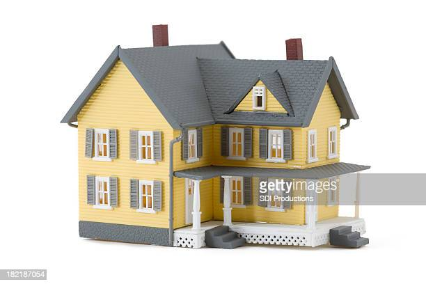 Yellow Miniature House Isolated on White