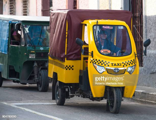 Yellow 'motoneta' for the transportation of urban passengers In order to control prices of the private sector the Cuban government have introduced a...
