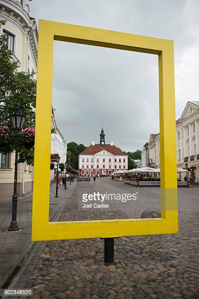 Yellow National Georgraphic frame and town hall in Tartu, Estoni