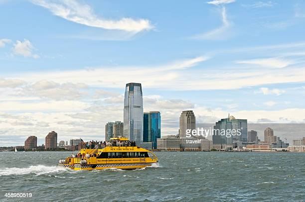 Yellow New York water taxi boat on Hudson River