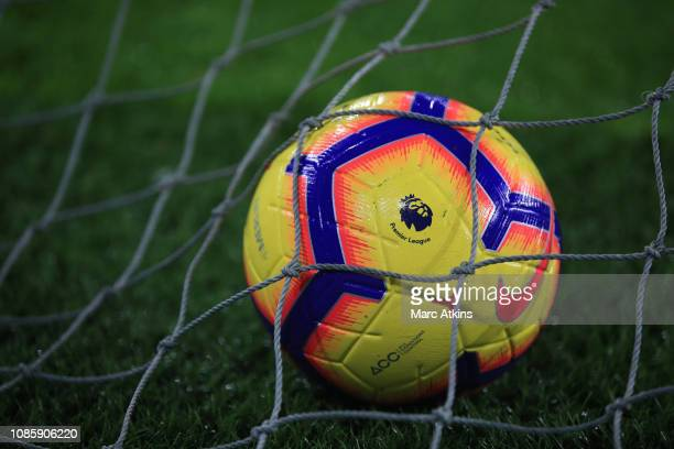 A yellow Nike Merlin winter football in the net during the Premier League match between Cardiff City and Manchester United at Cardiff City Stadium on...