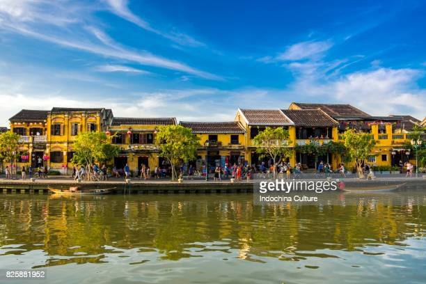 yellow old houses of ancient town hoi an nearby thu bon river - vietnam stock pictures, royalty-free photos & images