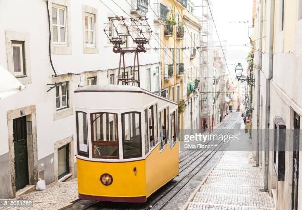 yellow old tram in lisbon - portugal stock pictures, royalty-free photos & images