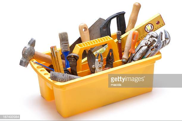 Yellow open toolbox with handle filled with tools