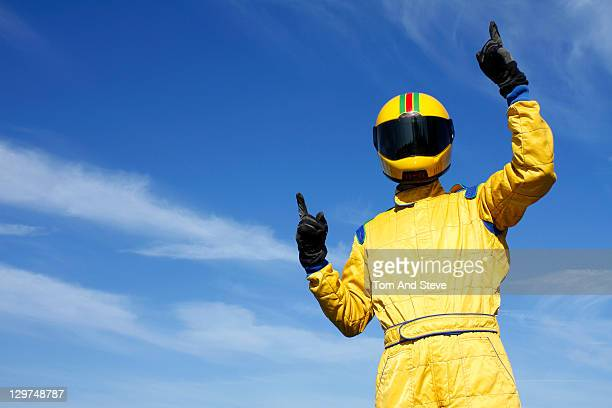 Yellow Overall Racing Driver Celebrates win