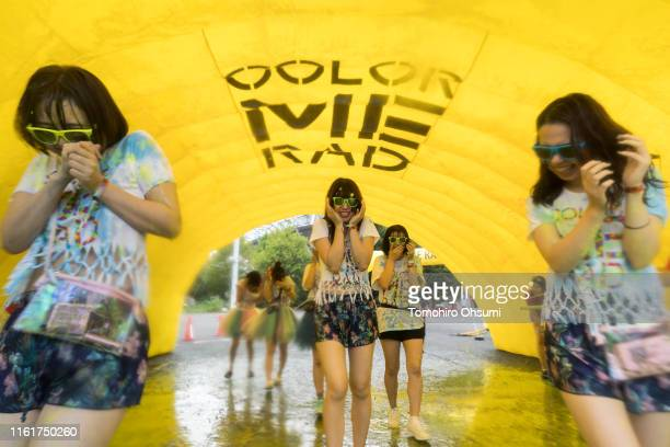 Yellow paint is sprayed to participants during the Color Me Rad Tokyo 2019 at the Ajinomoto Stadium on July 13 2019 in Tokyo Japan Participants in...