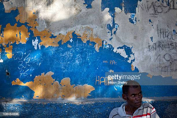 Yellow paint shows through a top coat of blue at the Haitian National Police AntiGang headquarters a reminder of its previous incarnation as an...