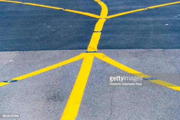 Yellow painted lines or markings in an airport ramp or tarmac