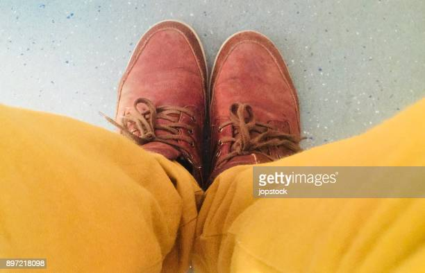 Yellow pants and brown leather shoes