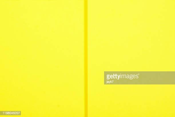 yellow paper background - geschichtet stock-fotos und bilder