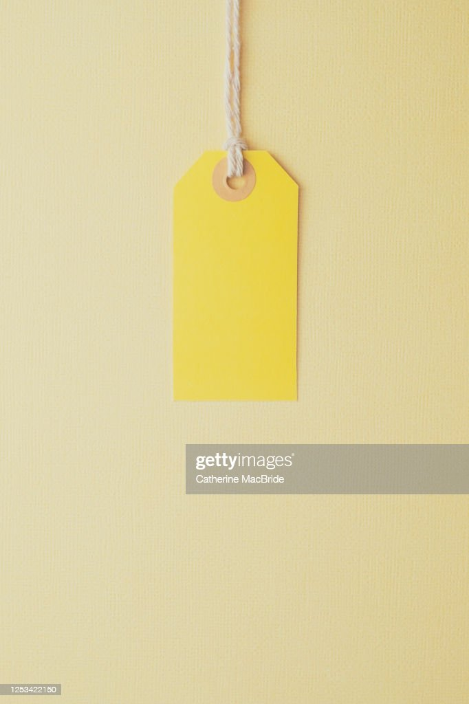 Yellow Paper Label on a Yellow Background : Stock Photo