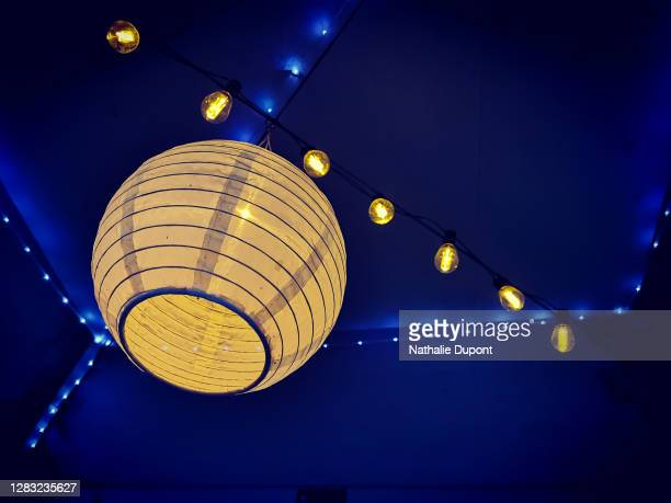 yellow paper lantern and small blue and yellow lights - charleroi stock pictures, royalty-free photos & images