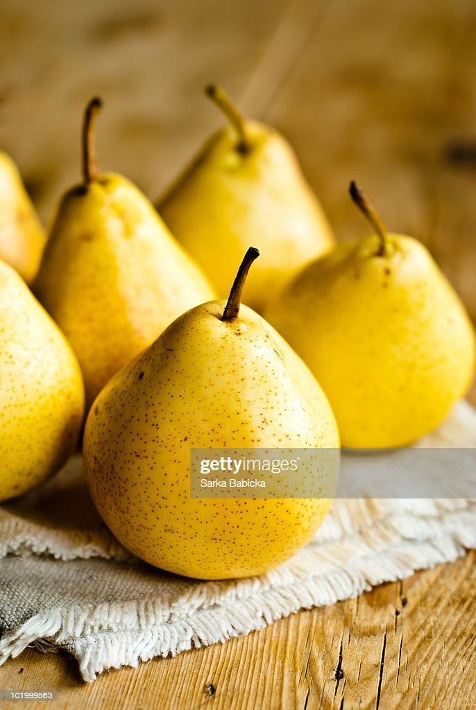 Yellow pears on a table : ストックフォト