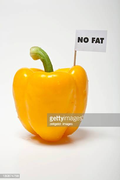 yellow pepper, flag saying no fat - captions stock photos and pictures