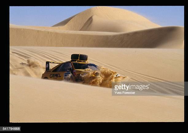 A yellow Peugeot car goes through the Niger desert during the N'Gourti Dirkhou leg of the 12th ParisDakar rally | Location Between Dirkhou and...