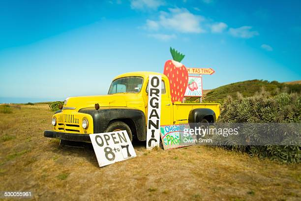 yellow pickup truck and strawberry jam advertisement on roadside, big sur, davenport, california, usa - roadside stock pictures, royalty-free photos & images